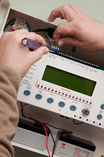 Fire alarm training maintenance course close up of hands servicing alarm panel