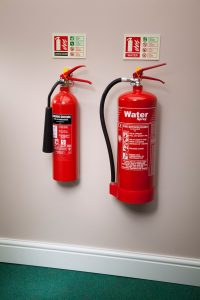 Co2 and water fire extinguisher next to each other on wall fire extinguisher technician